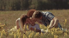 Young mother and father giving their child a kiss Stock Footage