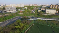 Cityscape with traffic near several soccer fields of Spartak Club Stock Footage