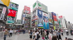 Timelapse of tourist people walking in Dotonbori bridge in Namba osaka japan Stock Footage
