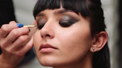 Professional make up artist working on a hispanic latina model model Stock Footage
