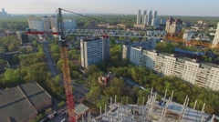 Street traffic near construction site with tall crane Stock Footage