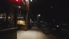POV Walking Historic Downtown Flagstaff Street At Night Stock Footage