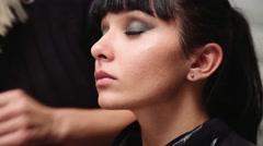 Professional make up artist working on a hispanic latina model model Stock Footage
