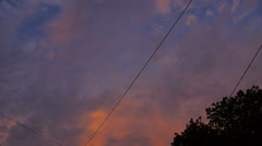 Pink sunset clouds with wire power in the city Stock Footage