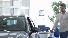 Man opens car door at the dealership Stock Footage