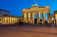 Brandenburg gate illuminated in Berlin, Germany Stock Photos