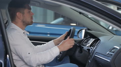 Man examines car interior at the dealership Stock Footage