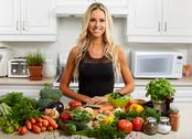 Young woman cooking in the kitchen. Stock Photos