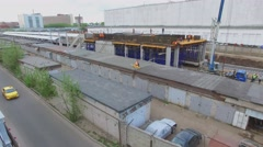 Builders work on construction site of railway station Stock Footage