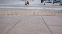 Foot crosswalk. People cross the road. feet walking on the pavement. Stock Footage