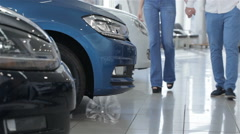 Couple stands near the blue car Stock Footage