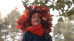 4k close-up portrait of happy smiling beautiful cute little girl in a wreath Stock Footage