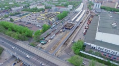 Transport traffic on bridge near construction site of railroad station Stock Footage