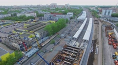 Cityscape with car traffic on bridge near building site of railway station Stock Footage