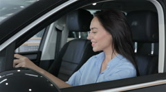 Woman touching the steering wheel in the car Stock Footage
