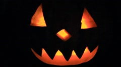 Fabulous pumpkin with face glowing on Halloween Stock Footage