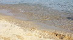 Female feet legs walking on the sand beach Arkistovideo