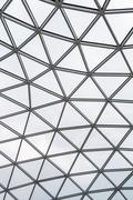 Glass roof of a modern building. Overlapping roof. Stock Photos