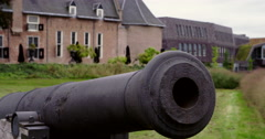 Gun in front of Dutch medieval castle in in the Netherlands Europe Stock Footage