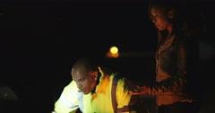 4K Roadside mechanic checking the car engine of broken down female motorist Stock Footage