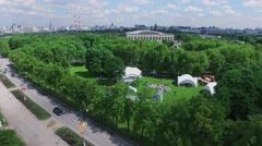 Public garden Luzhniki with many people watch acrobatic performance Stock Footage