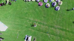 Juggler performs on grass in park Luzhniki during YOTA company event Stock Footage