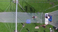 Woman swing on trapeze of aerial acrobats school in park Luzhniki Stock Footage