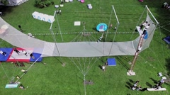 Woman sways on trapeze of aerialists school during YOTA company event Stock Footage