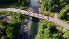 Aerial Cars Traveling Over Red Parker Truss Bridge North Bend, Washington Stock Footage