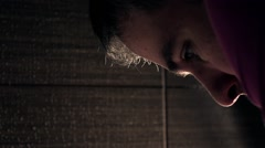 Super slow motion video of a handsome man washing his face Stock Footage