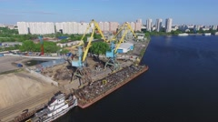 Barge is being loaded by waste metal in South River Port Stock Footage