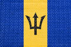 Flag of Barbados on brick wall texture background Stock Photos