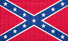 Confederate rebel flag on brick wall texture Stock Photos