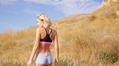Sexy smile girl enjoy life at beautiful wheat field in sport shorts touch nature Stock Footage