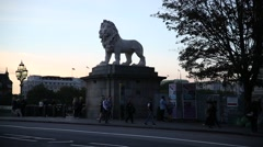 Lion on Westminster Bridge on a sunset in England Stock Footage