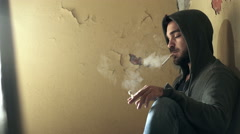 Young drug dealer smoking in a basement and pass drug to a customer Stock Footage