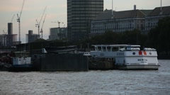 Huge boats on Thames River in Central London Stock Footage