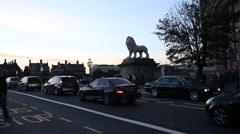 Lion on Westminster Bridge with heavy traffic Stock Footage