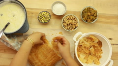 Ramadan recipes celebrating For Eid al-Fitr, Uum Ali, Egyptian Bread Pudding Stock Footage