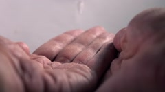 Super slow motion video of man's hands being washed Stock Footage