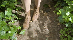 Closeup Of Woman's Hiking Boots As She Walks Along Nature Trail In Forest Stock Footage