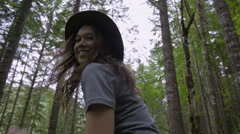 Closeup Of Carefree Young Woman As She Gets A Shoulder Ride Through The Forest Stock Footage