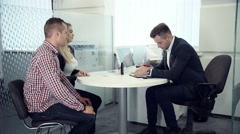 Business broker having a meeting with clients Stock Footage