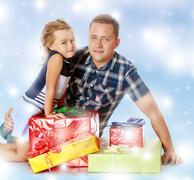 Little girl with my dad about gifts. Stock Photos