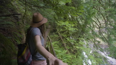 Young Couple Holding Hands, Woman Leading Boyfriend Down Trail, POV Concept Stock Footage