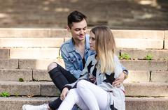 Cute couple on a date in the park on a sunny day Stock Photos