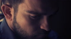 young man with beard in twilight looks at the camera Stock Footage