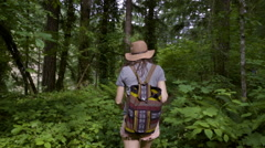 Young Woman Walks (Away From Camera) Down Nature Trail Stock Footage