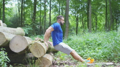 4K Young fit man working out in the woods. Shot on RED Epic. Stock Footage