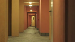 Man flees running from something in an empty corridor abandoned Stock Footage